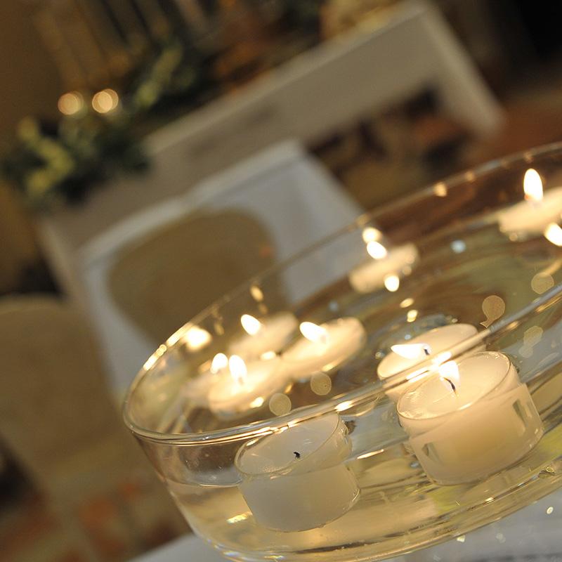 composizione fiori candele chiesa mantova